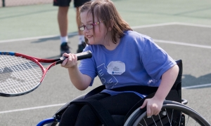 Emily playing wheelchair tennis