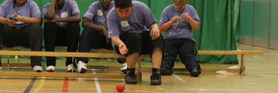 Young children playing Boccia